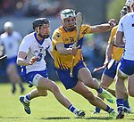 Barry Coughlan of Waterford  in action against Aron Shanagher of Clare during their National League game at Cusack Park. Photograph by John Kelly.