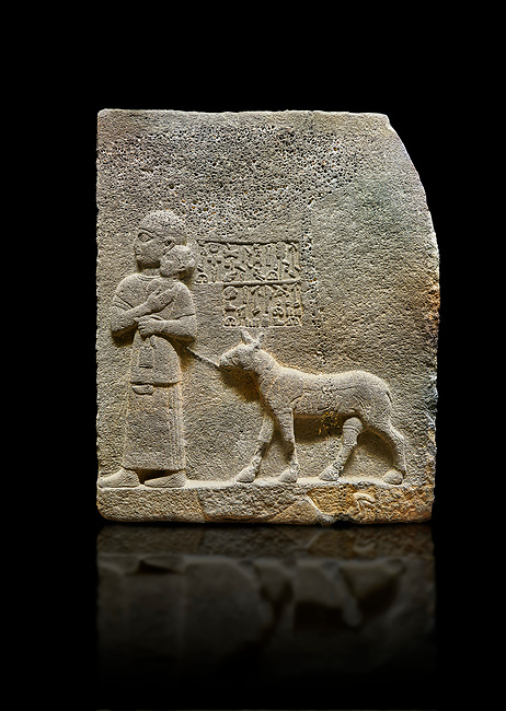 """Hittite monumental relief sculpted orthostat stone panel of Royal Buttress. Basalt, Karkamıs, (Kargamıs), Carchemish (Karkemish), 900-700 B.C. Anatolian Civilisations Museum, Ankara, Turkey<br /> <br /> The queen carries her youngest son. The hieroglyphs located above read; """"and this is Tuwarsais; the prince desired by the ruler, whose exclusiveness has been exposed"""". While the queen carries her son in her lap, she holds the rope of the colt coming behind with her other hand. The muscles of the colt are schematic. <br /> <br /> Against a black background."""