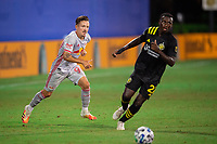 LAKE BUENA VISTA, FL - JULY 16: Marc Rzatkowski #90 of the New York Red Bulls passes the ball during a game between New York Red Bulls and Columbus Crew at Wide World of Sports on July 16, 2020 in Lake Buena Vista, Florida.
