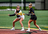 17 April 2021: University of Vermont Catamount Midfielder Jen Williams, a Junior from St. Louis, MO, faces off against UMBC Retriever Midfielder Megan Halczuk, a Sophomore from Fawn Grove, PA, to start play at Virtue Field in Burlington, Vermont. The Lady Cats fell to the Retrievers 11-8 in the America East Women's Lacrosse matchup. Mandatory Credit: Ed Wolfstein Photo *** RAW (NEF) Image File Available ***