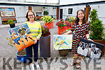 Jane Deasey and Clem O'Keeffe display the pictures on display in the Baile Mhuire Day Care Centre on Thursday raising funds for older person services