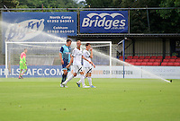 Will De Havilland  of Wycombe Wanderers looks bemused after the sprinklers come on during the first half in the Friendly match between Aldershot Town and Wycombe Wanderers at the EBB Stadium, Aldershot, England on 26 July 2016. Photo by Alan  Stanford.