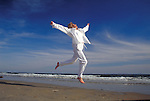 happy woman leaping on beach
