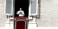 Papa Francesco recita l'Angelus domenicale affacciato su piazza San Pietro dalla finestra del suo studio. Citta' del Vaticano, 3 dicembre, 2017.<br /> Pope Francis recites the Sunday Angelus noon prayer from the window of his studio overlooking St. Peter's Square, at the Vatican, on December 3, 2017.<br /> UPDATE IMAGES PRESS/IsabellaBonotto<br /> <br /> STRICTLY ONLY FOR EDITORIAL USE