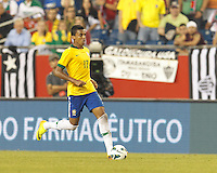 Brazil midfielder Luiz Gustavo (17) brings the ball forward.  In an international friendly, Brazil (yellow/blue) defeated Portugal (red), 3-1, at Gillette Stadium on September 10, 2013.