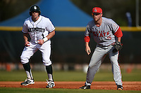 Ball State Cardinals first baseman Brandon Estep (15) holds on Nick Ruppert (1) during a game against the Dartmouth Big Green on March 7, 2015 at North Charlotte Regional Park in Port Charlotte, Florida.  Ball State defeated Dartmouth 7-4.  (Mike Janes/Four Seam Images)