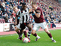 ST MIRREN'S NIGEL HASSELBAINK AND HEARTS' DANNY GRAINGER CHALLENGE FOR THE BALL
