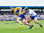 Shane O Donnell of Clare  in action against Noel Connors of Waterford during their Munster  championship round robin game at Cusack Park Photograph by John Kelly.