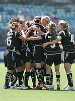 FC Gold Pride players celebrate Kimberly Yokers opening goal. FC Gold Pride defeated Washington Freedom 3-2 at Buck Shaw Stadium in Santa Clara, California on August 1, 2009.