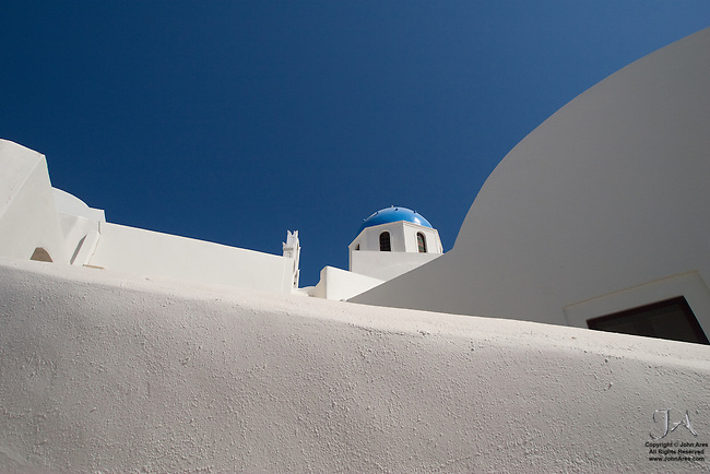Lookling up at Blue Dome Church in Oia.