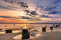 Sunset at low tide in the small shrimping town of Mayport, Florida.