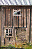 Traditional style Swedish wooden painted house. A door Window Fading peeling painting. Smaland region. Sweden, Europe.