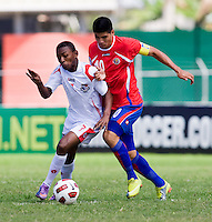 Dario Wright (7) of Panama fights for the ball with Gabriel Leiva (10) of Costa Rica during the quarterfinals of the CONCACAF Men's Under 17 Championship at Catherine Hall Stadium in Montego Bay, Jamaica. Panama defeated Costa Rica, 1-0.
