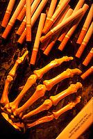 Smoking kills: cigarettes and skeleton hand