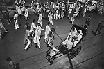 Nuns from Missionaries of Charity on a rickshaw crosses a procession of Muslim people on the ocassion of Muhhamad's birthday in Kolkata India.