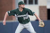 Michigan State Spartans pitcher Mike Mokma (20) attempts to pickoff a runner at second against the Michigan Wolverines during the NCAA baseball game on April 18, 2017 at Ray Fisher Stadium in Ann Arbor, Michigan. Michigan defeated Michigan State 12-4. (Andrew Woolley/Four Seam Images)