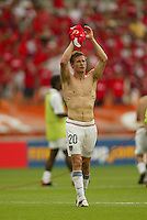 Brian McBride applauds the crowd after the game. The USA tied South Korea, 1-1, during the FIFA World Cup 2002 in Daegu, Korea.