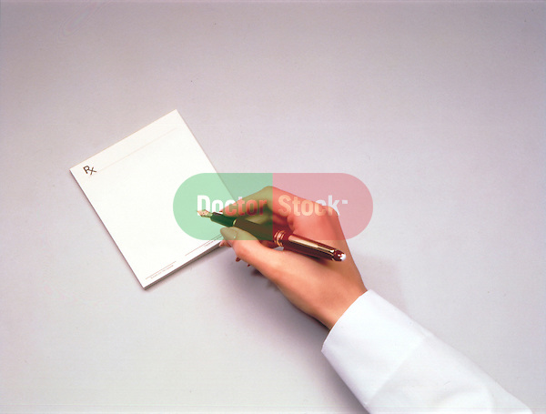 woman doctor hand writing prescription