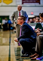 8 January 2020: Stony Brook University Seawolf Associate Head Coach Bryan Weber watches play in the first half against the University of Vermont Catamounts at Patrick Gymnasium in Burlington, Vermont. The Seawolves defeated the Catamounts 81-77 in a closely fought game. Mandatory Credit: Ed Wolfstein Photo *** RAW (NEF) Image File Available ***