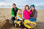 Tommy, Emma, Matilda and Braxton Carmody enjoying a stroll on Banna beach on Sunday.