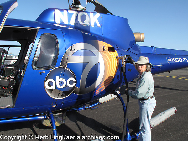 Flight instructor and airport employee Peggy Bakker fuels ABC Channel 7's Eurocopter at Petaluma Municipal Airport, Petaluma, Sonoma County, California.