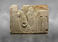 Alaca Hoyuk Sphinx Gate Hittite monumental relief sculpted orthostat stone panel. Andesite, Alaca, corum, 1399 - 1301 B.C.  King and queen in front of the altar. <br /> <br /> The king carries the kingdom sceptre - lituus in his right hand, and extends his left hand forward for worship. The queen wears a fancy dress hanging down to the floor; both figures wear earrings with a large ring.<br />  Anatolian Civilizations Museum, Ankara, Turkey