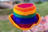 Peru, Urubamba Valley.  Peruvian Hat, Traditional Incan Rainbow Colors.