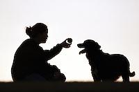 woman and her dog playing ball