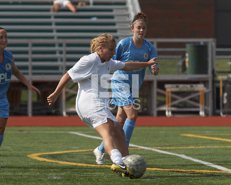 Boston Aztec midfielder Riley Houle (22) takes a shot. In a Women's Premier Soccer League (WPSL) match, Boston Aztec (white) defeated Seacoast United Mariners (blue), 2-1, at North Reading High School Stadium on Arthur J. Kenney Athletic Field on on June 23, 2013. Due to injuries through the season, Seacoast United Mariners could only field 10 players.
