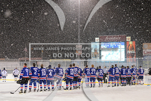Rochester Amerks Alumni players line up for the national anthem before The Frozen Frontier Buffalo Sabres vs. Rochester Amerks Alumni Game at Frontier Field on December 15, 2013 in Rochester, New York.  (Copyright Mike Janes Photography)