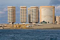 Tripoli, Libya - Dhat al-Imad Office Complex and Corinthia Bab Hotel, Mediterranean Sea in foreground.