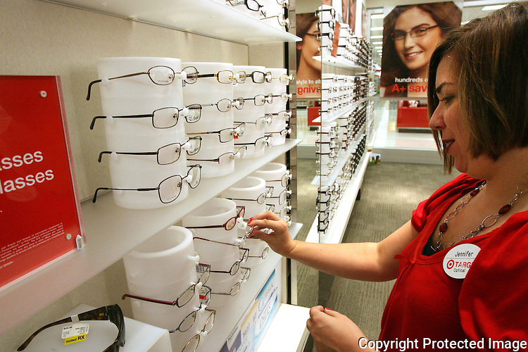 Jennifer Alemany works in the new optical department of the Murrieta Super Target store in 2009.  photo for The Californian