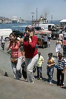 Turkish women on their mobile phones in Eminonu, Istanbul, Turkey