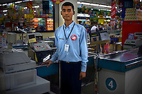 19 year old Mohamad Anang, high school student at Kartini Emergency School, works as a cashier of a foreign supermarket chain where he now earns a decent wage. The 'Twin Teachers' recommended Anang to the supermarket's director, and after passing a few tests, he was given a job. Since the early 1990s, twin sisters Sri Rosyati (known as Rossy) and Sri Irianingsih (known as Rian) have used their family inheritance to set up and run 64 schools in different parts of Indonesia, providing primary education combined with practical skills to some of the country's most deprived children.   .