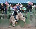 Garrett Crist competes in the bull riding event at the Smackdown Tour at Fuji Park in Carson City, Nev., on Saturday, June 7, 2014.<br /> Photo by Cathleen Allison