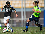 Aleksandar Randelovic of Sun Pegasus FC (L) followed by  Aender Naves Mesquita of Wofoo Tai Po (R) during the HKFA Premier League between Wofoo Tai Po vs Sun Pegasus at the Tai Po Sports Ground on 22 November 2014 in Hong Kong, China. Photo by Aitor Alcalde / Power Sport Images