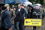 © Joel Goodman - 07973 332324 . 28/03/2015 . Manchester , UK . Queue of Conservative Party delegates in the rain ahead of the Conservative Party Spring Forum at the Old Granada Studios , Quay Street , Manchester . Photo credit : Joel Goodman