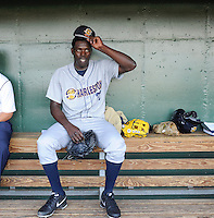 Pitcher Rafael De Paula (37) of the Charleston River Dogs waits in the dugout for the start a game against the Greenville Drive on Saturday, April 6, 2013, at Fluor Field at the West End in Greenville, South Carolina. De Paula, a free agent from the Dominican Republic, threw 4.1 innings, striking out 11 and giving up five hits and two runs. Charleston won Game 1 of a doubleheader, 6-2. De Paula did not figure in the decision. (Tom Priddy/Four Seam Images)