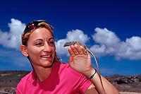 Tourist and Blue whiptail lizard, Cnemidophorus murinus ruthveni, Netherland Antilles, Caribbean, Atlantic, Bonaire, Bonaire, Washington, USA Slagbaai National Park, Boka Chikitu