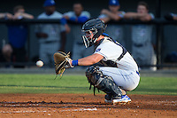 Burlington Royals catcher Zane Evans (17) warms the pitcher up between innings of the game against the Bluefield Blue Jays at Burlington Athletic Stadium on June 28, 2016 in Burlington, North Carolina.  The Royals defeated the Blue Jays 4-0.  (Brian Westerholt/Four Seam Images)