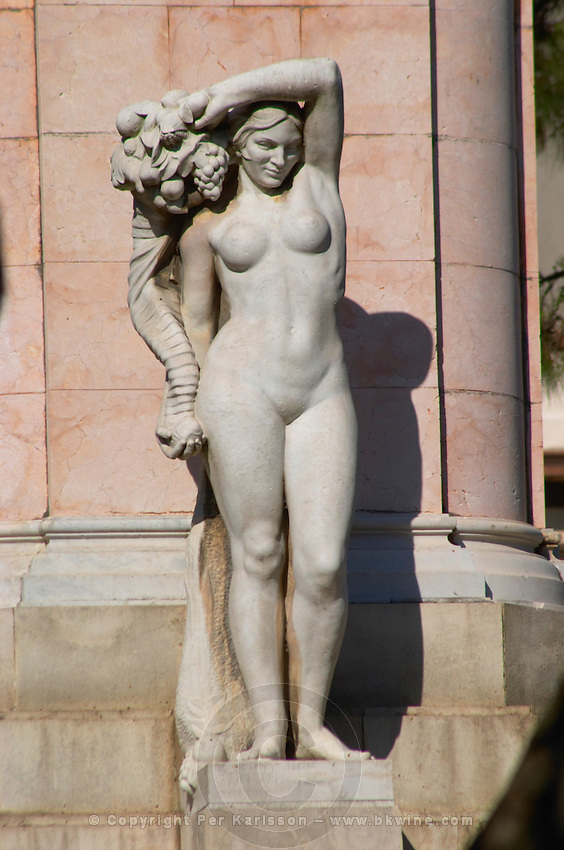 A statue on the Plaza Zabala a standing naked woman carrying a horn of plenty cornucopia with fruits and a bunch of grapes Montevideo, Uruguay, South America