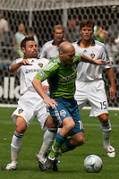 Freddie Ljungberg of the Seattle Sounders fights for the ball with Dema Kovalenko of the LA Galaxy at Quest Field on May 10, 2009. The Sounders and Galaxy played to a 1-1 draw.