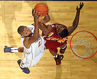 Dec. 30, 2010; Charlottesville, VA, USA; Virginia Cavaliers forward Akil Mitchell (25) fights for a loose ball with Iowa State Cyclones forward Calvin Godfrey (15) during the game at the John Paul Jones Arena. Iowa State Cyclones won 60-47. Mandatory Credit: Andrew Shurtleff-