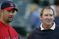Tim Wakefield of the Boston Red Sox talks with retired knuckleball pitcher Charlie Hough during a 2003 season MLB game at Angel Stadium in Anaheim, California. (Larry Goren/Four Seam Images)