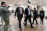 Sens. John Cornyn (R-Texas) and Cory Booker (D-N.J.) arrive at the Capitol on Wednesday, February 10, 2021 for the second day of the impeachment trial of former President Donald Trump.<br /> CAP/MPI/RS<br /> ©RS/MPI/Capital Pictures