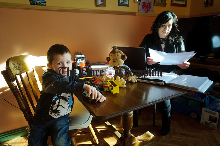 Killimer's Madeleine Dunne working at home on her a Fetac Level 5 Community Care and Childcare course while taking care of her four year old son MJ as well following the closure of the West Clare Early Years with the loss of 53 jobs. Photograph by John Kelly.