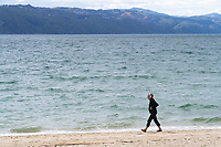 A woman walks along Freyberg Beach at 2pm, Thursday, during lockdown for the COVID19 pandemic in Wellington, New Zealand on Thursday, 23 April 2020. Photo: Dave Lintott / lintottphoto.co.nz