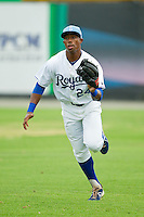Burlington Royals right fielder Alex Newman (24) makes a running catch during the Appalachian League game against the Pulaski Mariners at Burlington Athletic Park on July 20, 2013 in Burlington, North Carolina.  The Royals defeated the Mariners 6-5.  (Brian Westerholt/Four Seam Images)