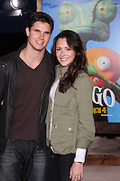 LOS ANGELES - FEB 14:  Robbie Amell, Italia Ricci arrives at the Rango Premiere at Village Theater on February 14, 2011 in Westwood, CA
