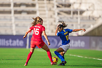ORLANDO, FL - FEBRUARY 24: Janine Beckie #16 of the CANWNT and Marta #10 of Brazil battle for the ball during a game between Brazil and Canada at Exploria Stadium on February 24, 2021 in Orlando, Florida.
